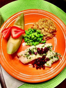 Haddock with pomogranates; whole rice; edamame beans; melon & strawberries