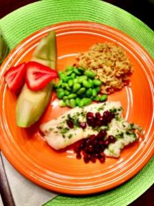 Haddock with pomogranates; whole rice; edamame beans; melon & strawberries